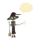 Cartoon witch casting spell with thought bubble Stock Photos