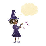 Cartoon witch casting spell with thought bubble Stock Photo