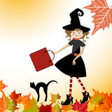 Cartoon Witch with cat and leaves Royalty Free Stock Photography