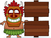 Cartoon Witch Doctor Sign. A cartoon illustration of a witch doctor with a wooden sign Royalty Free Stock Image