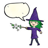 Cartoon witch girl casting spell with speech bubble Royalty Free Stock Image