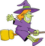 Cartoon witch riding a broom Stock Photography
