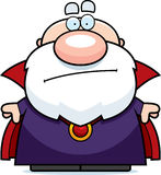 Cartoon Wizard Bored. A cartoon illustration of a wizard looking bored Stock Images