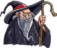 Cartoon wizard with a staff stock illustration