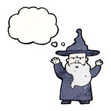 Cartoon wizard with thought bubble Stock Photos