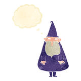 Cartoon wizard with thought bubble Stock Photo