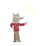 Cartoon wolf man pointing with thought bubble Royalty Free Stock Photo