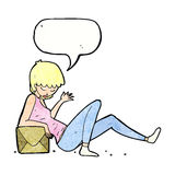 Cartoon woman leaning on package box with speech bubble Royalty Free Stock Image
