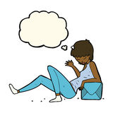 Cartoon woman leaning on package box with thought bubble Royalty Free Stock Photography