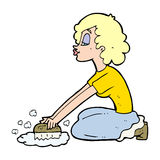 Cartoon woman scrubbing floor Stock Images