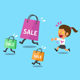 Cartoon a woman and shopping bags Royalty Free Stock Image