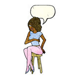 Cartoon woman sitting on bar stool with speech bubble Royalty Free Stock Photography