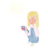 Cartoon woman sitting with cup of coffee with thought bubble Stock Photos