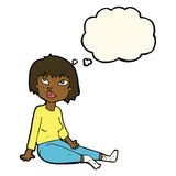 Cartoon woman sitting on floor with thought bubble Stock Images