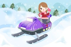 Woman is snowmobiling Royalty Free Stock Photo
