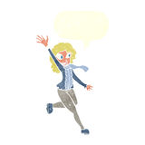 Cartoon woman waving dressed for winter with speech bubble Royalty Free Stock Image