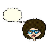 Cartoon woman wearing spectacles with thought bubble Stock Images
