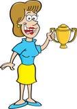 Cartoon women holding a trophy. Stock Photos