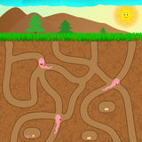Cartoon worms underground Royalty Free Stock Photo