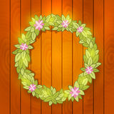 Cartoon wreath on wood wall. Vector background Stock Photo