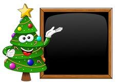 Cartoon xmas tree presenting blank chalkboard blackboard isolated Royalty Free Stock Image