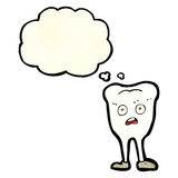 Cartoon yellowing  tooth with thought bubble Stock Photo