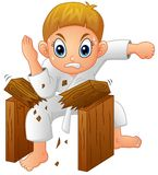 Cartoon Young boy breaking board Royalty Free Stock Photos