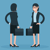 Cartoon young business women Stock Images