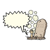 cartoon zombie rising from grave with speech bubble Royalty Free Stock Images
