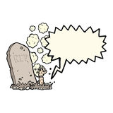 cartoon zombie rising from grave with speech bubble Stock Image
