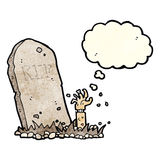 Cartoon zombie rising from grave with thought bubble Stock Photos