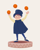Cartooned Happy Juggler Boy on Top of a Platform Stock Photo