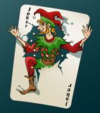 Cartooned Joker Jumping Out From Playing Card. Cartooned Joker Jumping Out of Playing Card on Blue Green Background Royalty Free Stock Photos