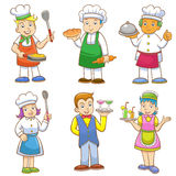 Cartoons of kids chefs and set of cooking Stock Photos
