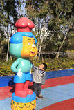 Cartoons statue spraying water. The little boy watching cartoons statue spraying water in zhonglun park, amoy city, china stock photos