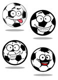 Cartoontd football or soccer balls mascots. Football or soccer balls cartoon characters with googly eyes and smiling faces suitable for sporting mascot or logo Royalty Free Stock Photography