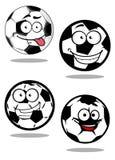 Cartoontd football or soccer balls mascots Royalty Free Stock Photography