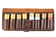 Cartridge. Leather bandolier with shotgun shells over white Royalty Free Stock Photos
