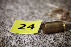 Cartridge .45 Auto on crime scene Stock Images