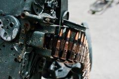 Cartridge belt of ammo at machine gun.  Royalty Free Stock Photos