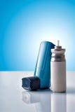 Cartridge and blue medicine inhaler with blue background front v Stock Images