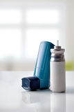 Cartridge and blue medicine inhaler in room front view vertical Royalty Free Stock Images