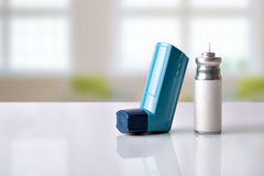 Cartridge and blue medicine inhaler in a room front view Stock Photo