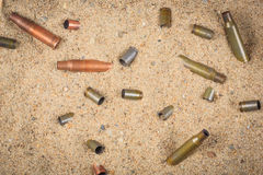 Cartridge cases on the sand Stock Photography