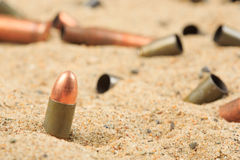 Cartridge cases on the sand Stock Images