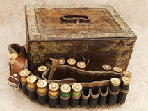 Cartridge for hunting rifle and old chest stock photo
