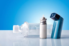 Cartridge inhaler and inhalation chamber with blue background fr Royalty Free Stock Image