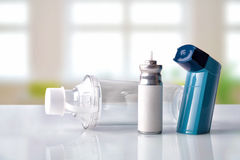 Cartridge inhaler and inhalation chamber in a room front view Royalty Free Stock Photography