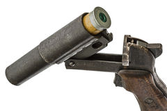 Cartridge is inserted into the barrel  flare gun, isolated Royalty Free Stock Photo