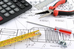 Cartridge,Pliers, Calculator,ruler and nuts Stock Images